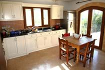 Kitchen with french windows to the terrace