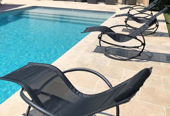 Comfortable loungers by the pool