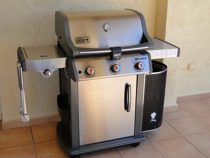 Weber gas barbecue (BBQ) with utensils on the terrace at Casa Windlenook