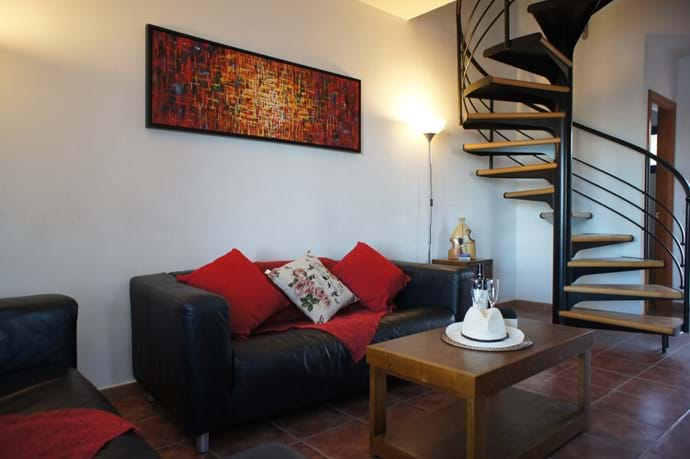 Sitting room with spiral staircase