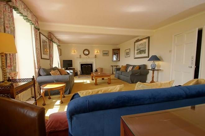 open fire in the sitting room in rural self catering for large families with fishing