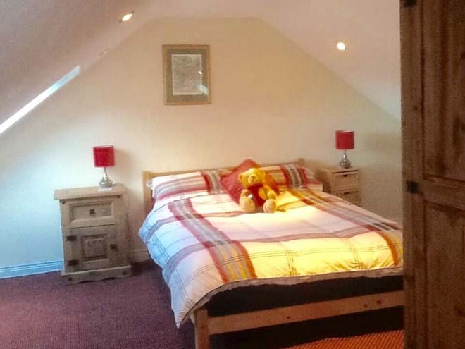 Upstairs family room double bed in the boat house