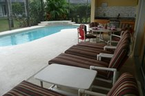 The pool, covered lanii , extensive furniture and outdoor litchen