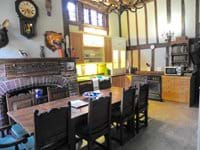Fantastic kitchen diner - place for the family around one table - note the beasts looking down at you