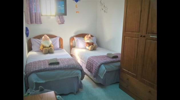 Nursery also has a wooden cot