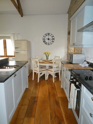 Socialble kitchen/diner with solid oak floors