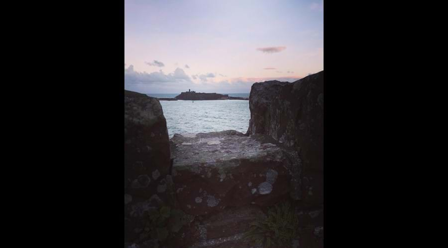 Pink morning skies above Peel Castle