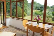Dine in the sun room or relax in the easy chairs while you watch the garden wildlife.