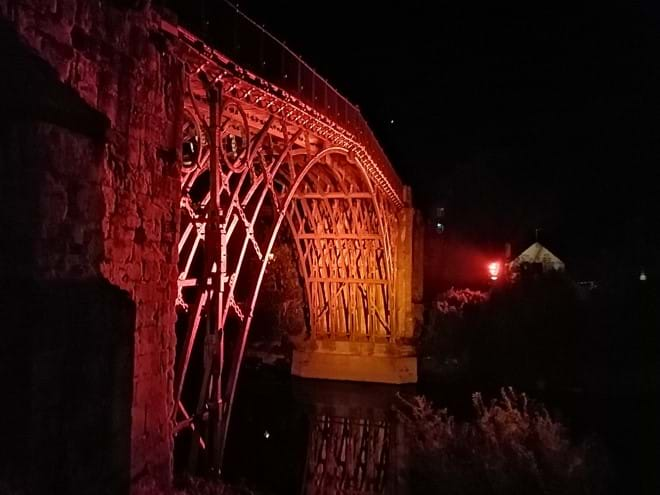 The Iron Bridge lit up in furnace colour
