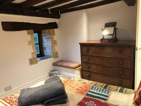 King size bedroom no.1 with exposed beams