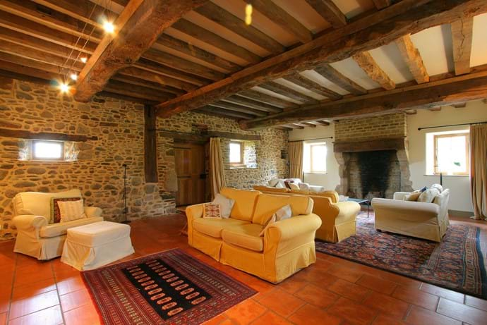 The huge reception room in the Farmhouse with two seating areas, games, TV & DVD
