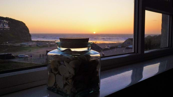 Watch the sun set over the sea (April - September) with a cool glass of something nice.