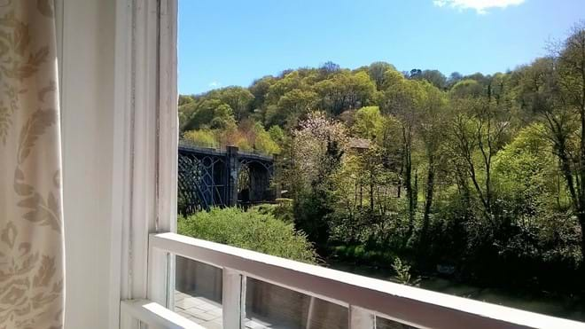 VIEW OF THE IRON BRIDGE FROM THE ARMCHAIR AT IRONBRIDGE VIEW TOWNHOUSE
