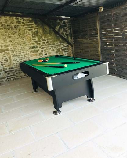 Games room with full size pool table.