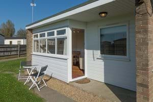 Sunny aspect with outside seating and large communal grassed area to front