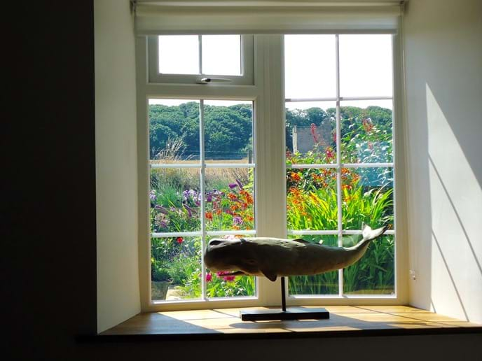 The lounge window looks across to the medieval Pele Tower opposite