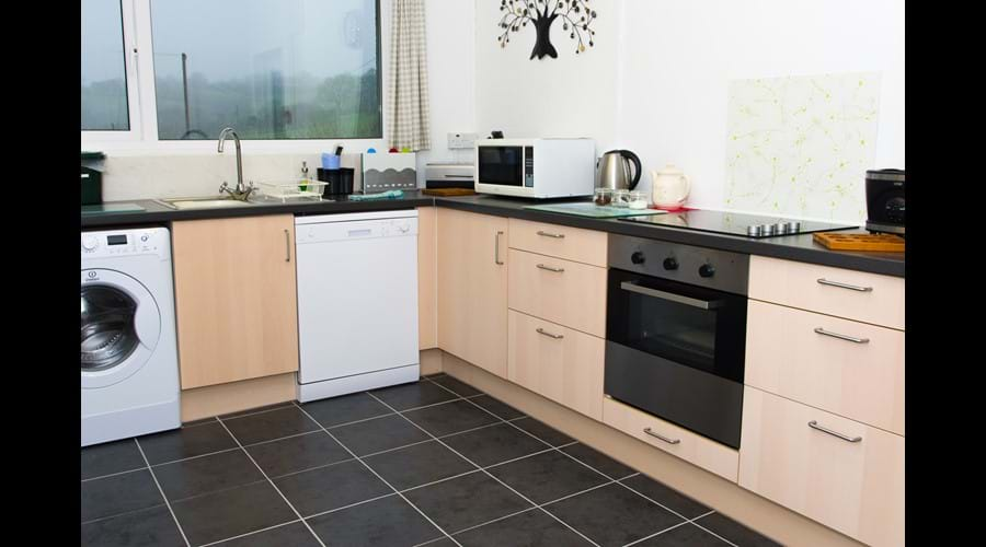Kitchen with views along Aeron Valley so you can enjoy the views when cooking!