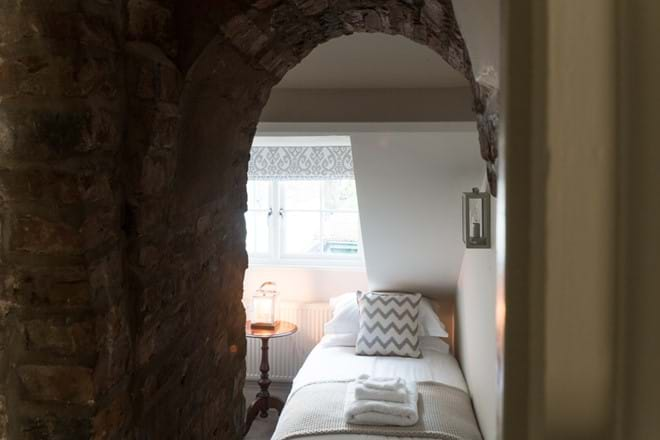 Twin bedroom looking through the archway