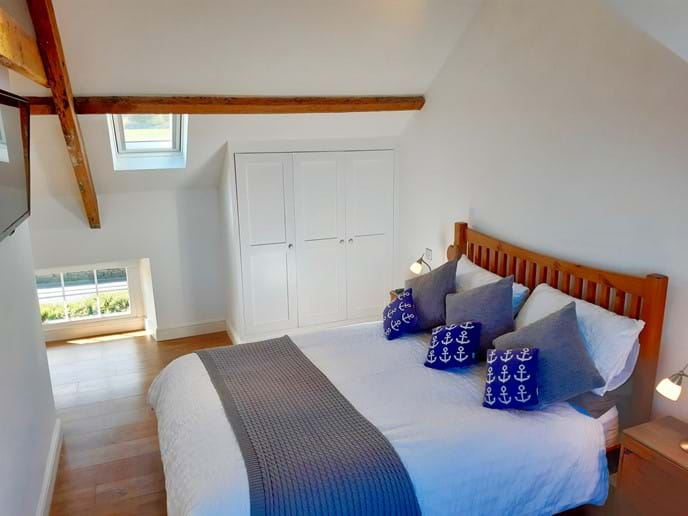 There is ample wardrobe space and good quality bed linen on the comfortable bed