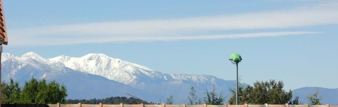 View of snowy Canigou from balcony in April