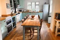 Well equipped country kitchen. The table comfortably seats 10-12 people