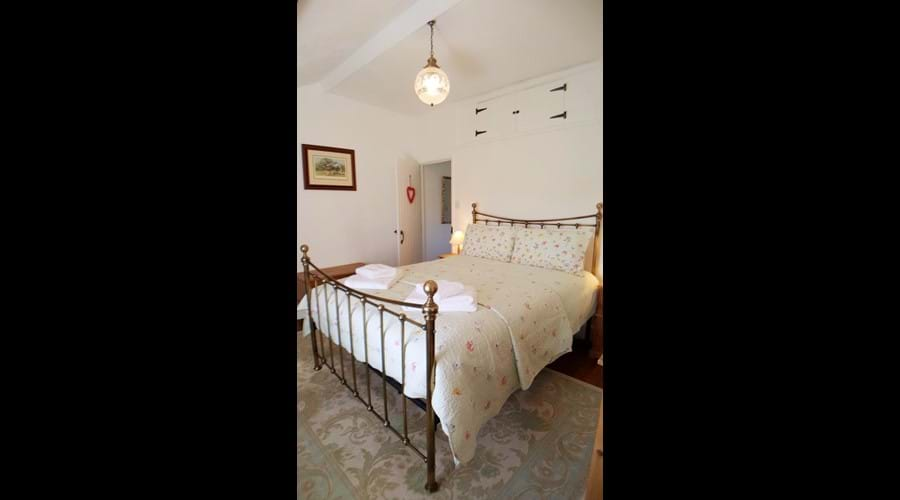 A large, Victorian styled bed frame with comfortable, deep mattress and choice of soft and medium/firm pillows....