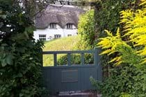 View of cottage through the front gate