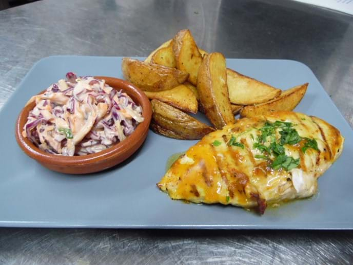 Peri Peri Chicken with Homemade Coleslaw and Potato Wedges.