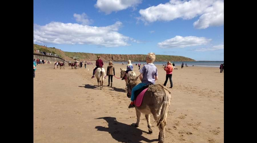 Have a donkey ride on Filey beach.
