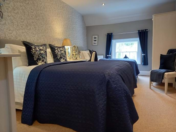 Beautiful decorated bedroom with King size bed & Single bed. View of the Iron Bridge from the window