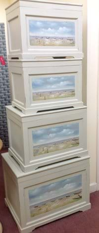 Storage boxes in different sizes featuring sea scenes