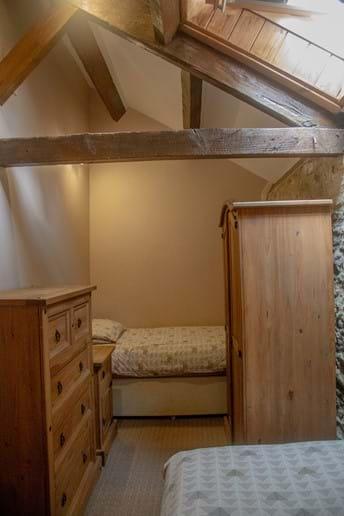 Laverock Lodge twin bedroom with beams