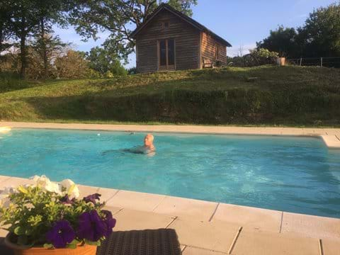 Heated pool shared by Dordogne holiday cottages