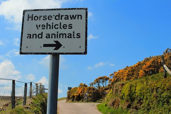 An Exmoor Road sign telling horse drawn vehicles to use a gate rather than cross a cattle grid