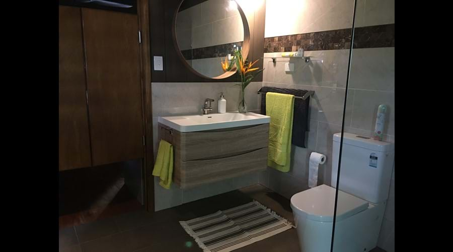 Luxurious, well appointed bathroom with ample storage.