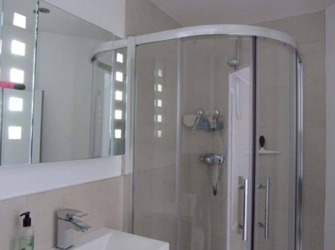 Master bedroom ensuite bathroom with shower, toilet and wash basin