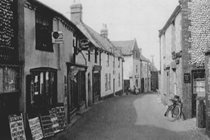 Blakeney High Street including The Ship Inn in the 19th century