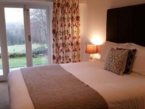 Have a duvet day whilst watching the wildlife - En suite Bedroom with french doors to the garden