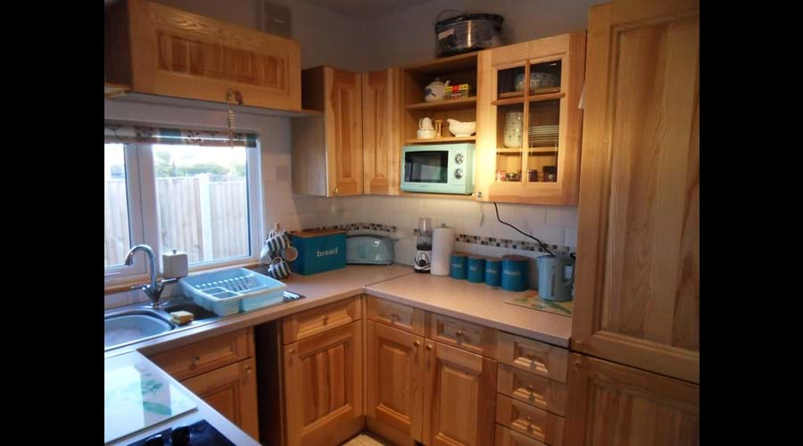 Lovely oak kitchen with built in fridge-freezer and dishwasher. Tea/coffee/biscuits/milk for your first drink on arrival