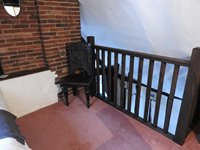 Attic single bed room with balustrade and view downstairs