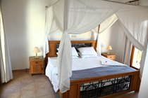 Master bedroom with four poster 2m x 2.2m bed (larger than superking).