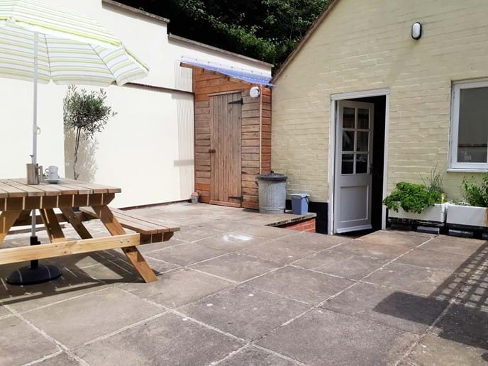 Private enclosed courtyard area at rear of the cottage leading from the kitchen