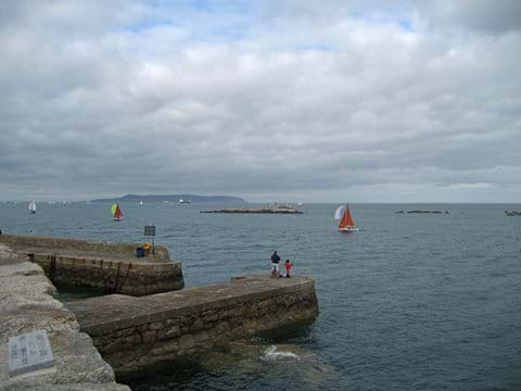 Take the Dart to Dalkey and take a ferry trip to the island in summer see http://www.visitdublin.com/discover-dalkey-an-illustrated-guide