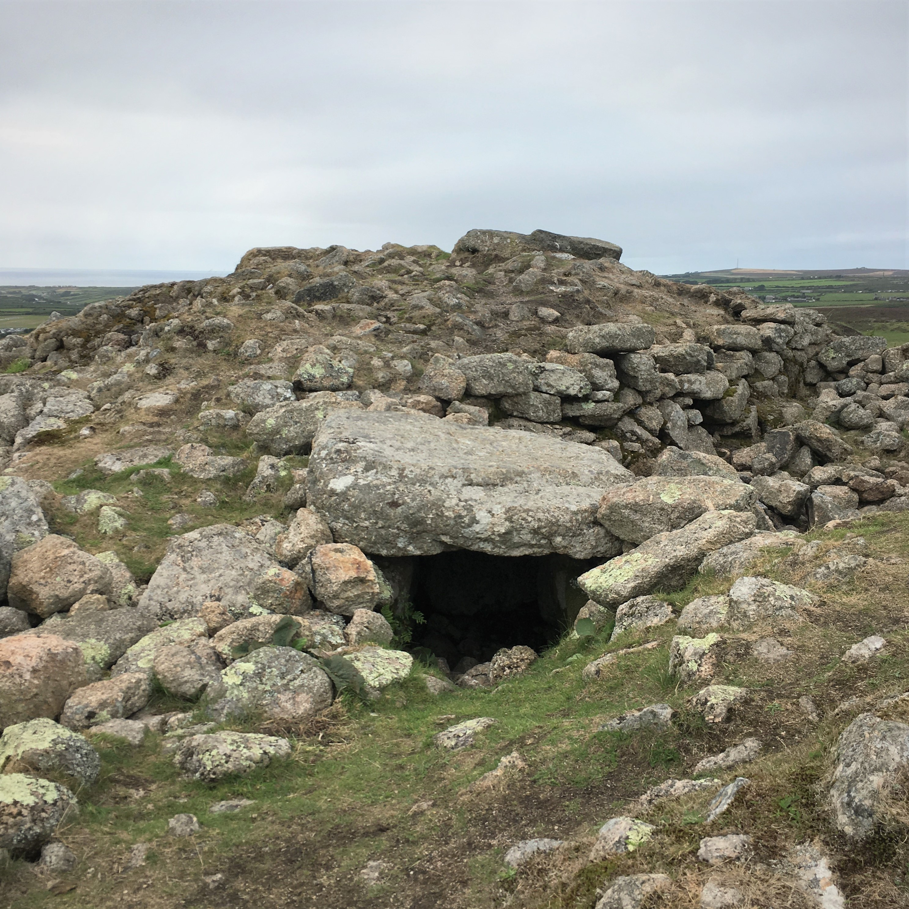 The summit of Chapel Carn Brea has a Neolithic/Early Bronze age burial chamber