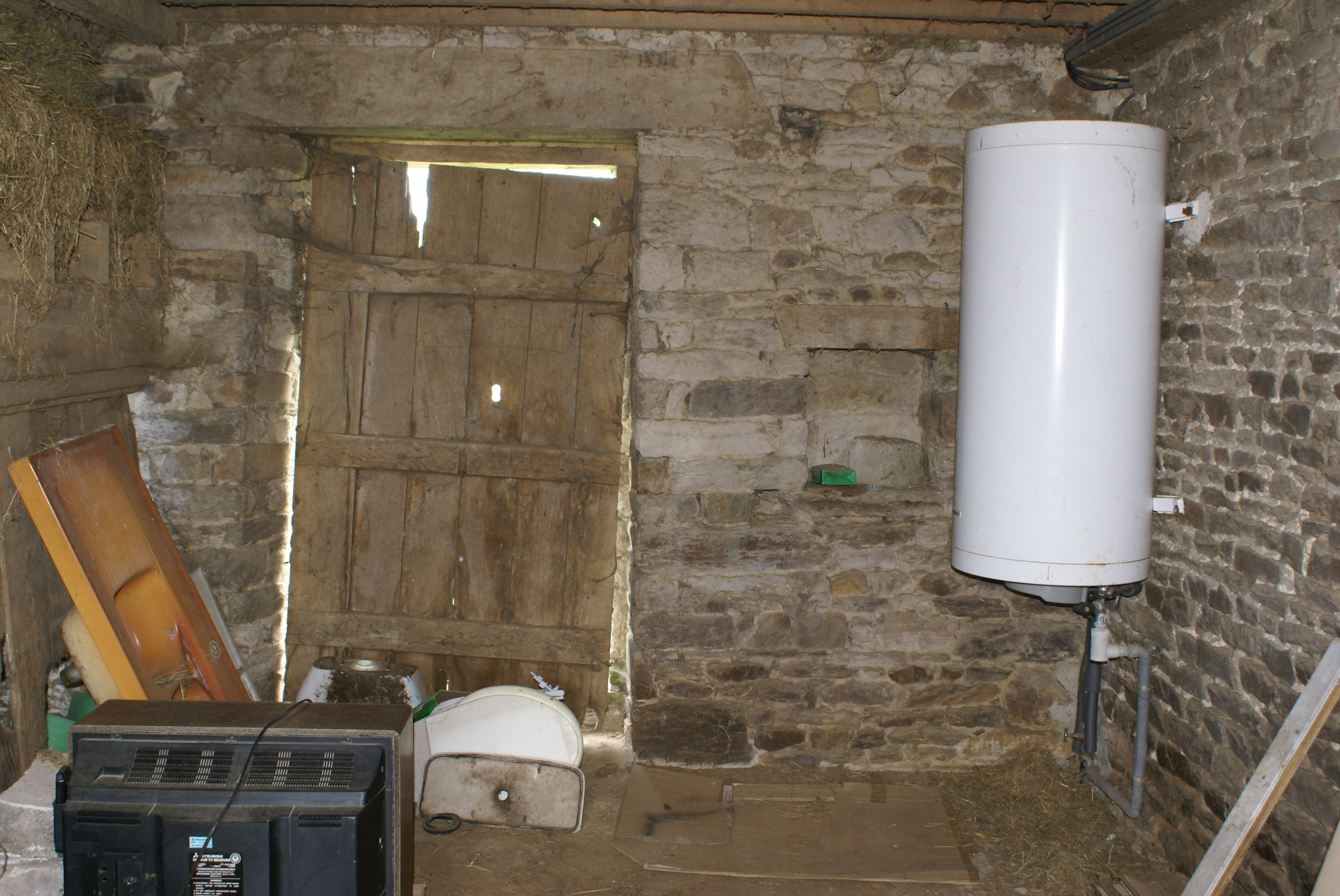 A before picture of the kitchen at Eco-Gites of Lenault, a holiday cottage in Normandy