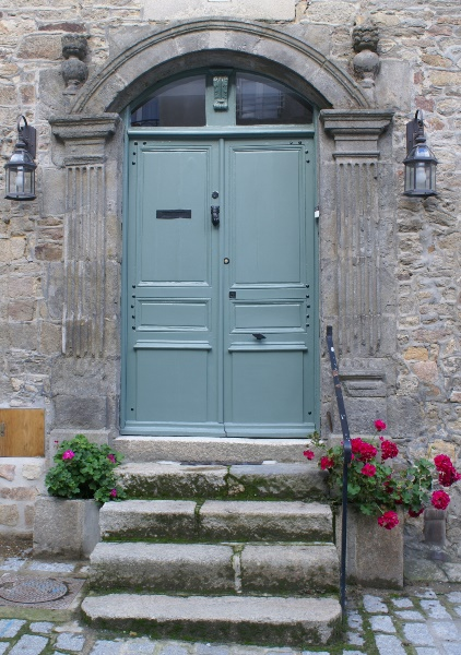 Door with geraniuns in Dinan, Brittany