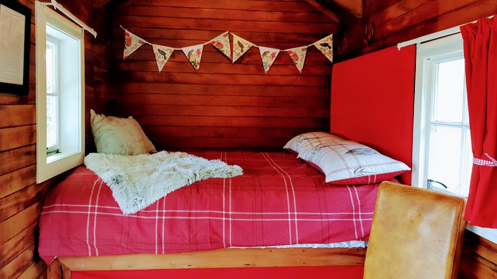 Jacks hut glamping tarawera bed