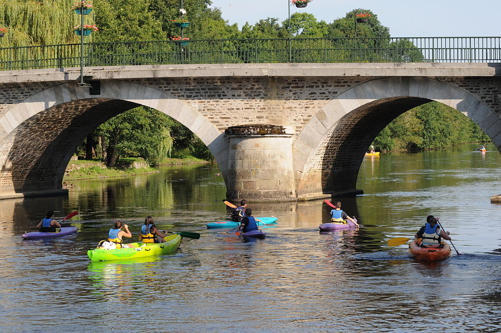 Kayakingunder the bridge at Pont D'Ouilly, Normandy
