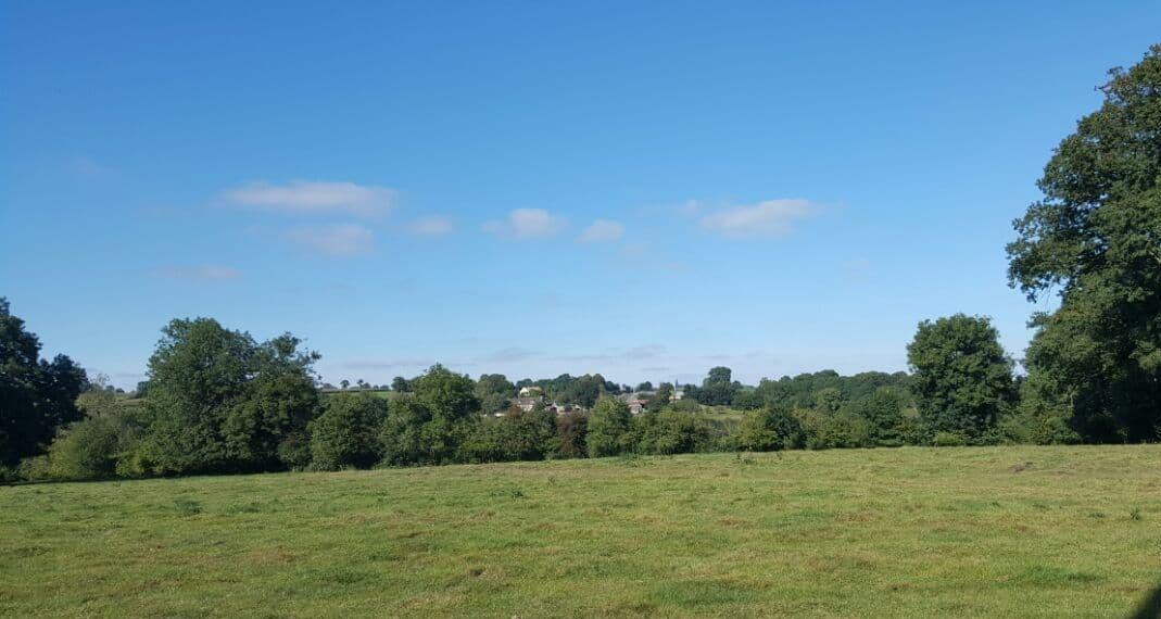 View across farmland to the village of Perigny, Calvados, Normandy