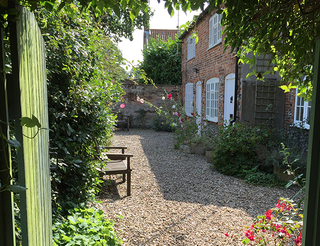 Walk through the secret gate to the peace and quiet of 8 Carpenters Cottages in the heart of Holt